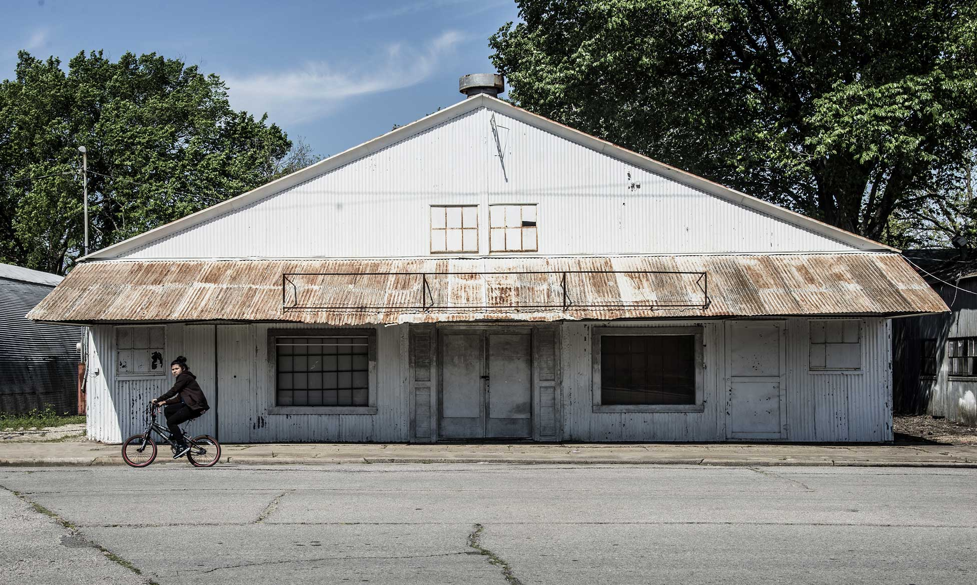14-a-Far-Fading-West,-Woman-on-Bike-(Bryan,-Texas),-2018